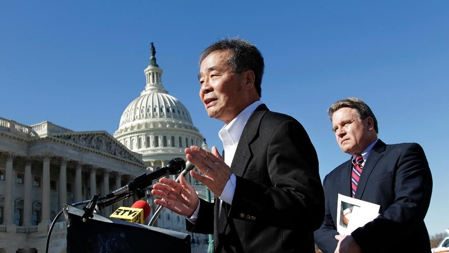 FILE - In this March 7, 2011 file photo, Harry Wu, left, speaks next to Rep. Chris Smith, R-N.J. at the Capitol in Washington. Wu, a longtime Chinese human rights campaigner, and author and founder of the Laogai Research Foundation, died Tuesday morning, April 26, 2016. He was 79. (AP Photo/J. Scott Applewhite, File)