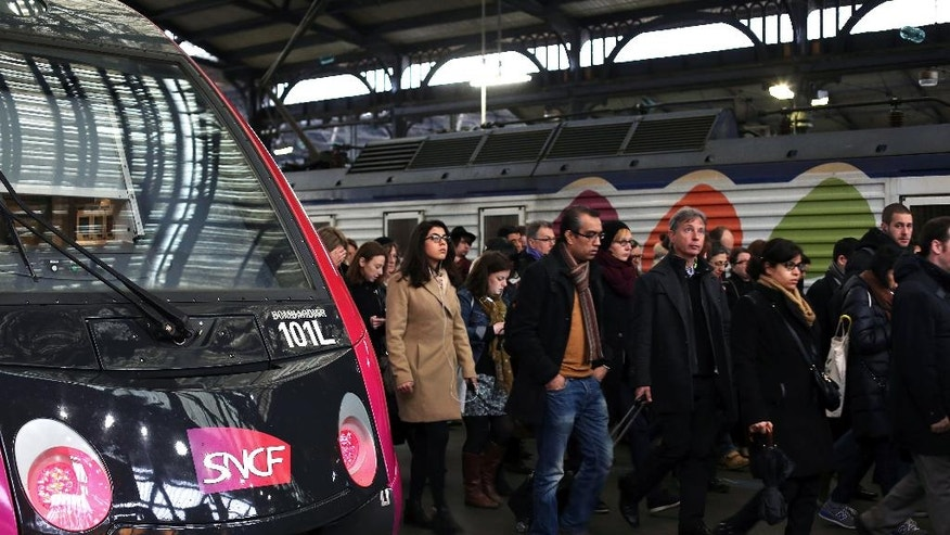 Commuters arrive at the Gare de l'Est train station in Paris, Tuesday, April 26, 2016. France's six rail unions have issued a joint call for a one-day strike that is set to disrupt local and national train traffic, but not international lines. (AP Photo/Thibault Camus)