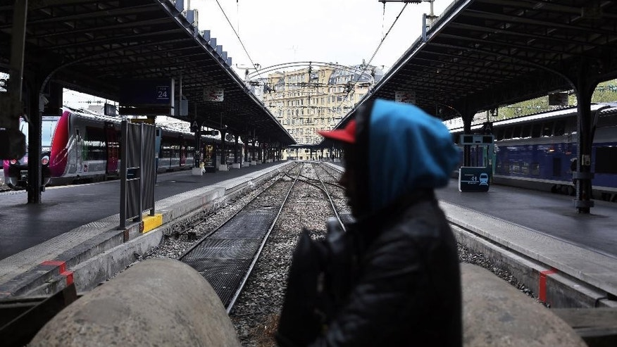 A man walks past empty platforms at the Gare de l'Est train station in Paris, Tuesday, April 26, 2016. France's six rail unions have issued a joint call for a one-day strike that is set to disrupt local and national train traffic, but not international lines. (AP Photo/Thibault Camus)