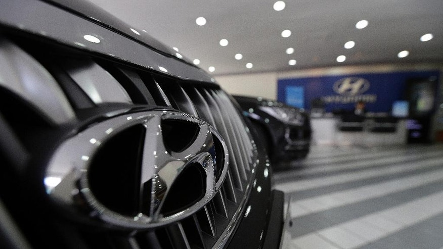 The logo of Hyundai Motor Co. is seen on a vehicle displayed at the company's showroom in Seoul, South Korea, Tuesday, April 26, 2016. Hyundai Motor Co. says its first-quarter net profit has dropped 12 percent over a year earlier as global sales declined.(AP Photo/Ahn Young-joon)