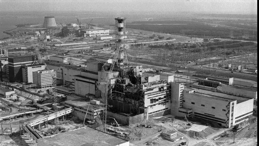 A 1986 file photo of an aerial view of the Chernobyl nuclear plant in Chernobyl, Ukraine showing damage from an explosion and fire in reactor four on April 26, 1986 that sent large amounts of radioactive material into the atmosphere.