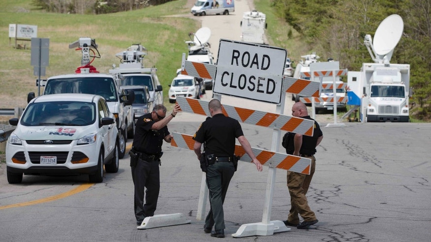 Authorities set up road blocks at the perimeter of a crime scene in Pike County, Ohio, on Friday, April 22, 2016.