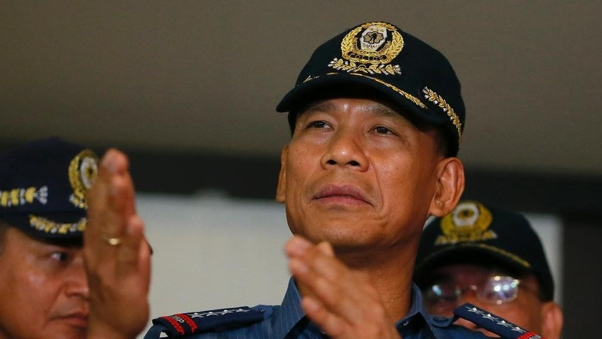 Philippine National Police Director General Ricardo Marquez talks to the media after reading a joint statement from the military and police on the beheading of Canadian hostage John Ridsdel of Calgary, Alberta by Muslim extremist Abu Sayyaf Group in southern Philippines Tuesday, April 26, 2016 at Camp Crame in suburban Quezon city northeast of Manila, Philippines. Ridsdel along with fellow Canadian Robert Hall, Norwegian Kjartan Sekkingstad and Filipino Marites Flor were kidnapped last September from a marina on southern Samal Island with the militants threatening to behead one of the hostages if the large ransom was not paid Monday. (AP Photo/Bullit Marquez)