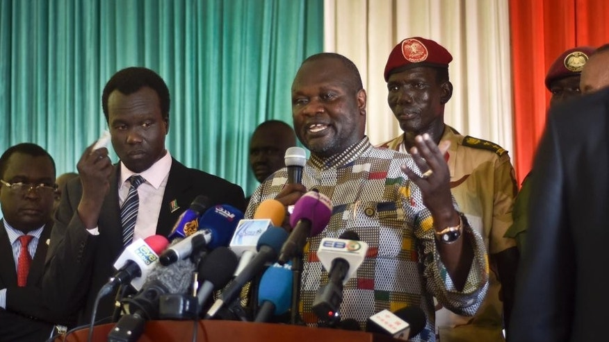 South Sudan's rebel leader and now Vice President Riek Machar addresses the media upon his return at the airport in the capital Juba, South Sudan, Tuesday, April 26, 2016. Machar returned to the capital Tuesday to become vice president and to try to end the civil war that in two and a half years has killed tens of thousands of people and forced more than 2 million from their homes. (AP Photo/Jason Patinkin)