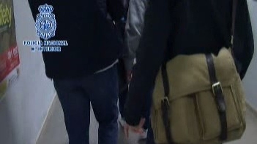 Spanish National Police released footage of the extradition without showing the suspect's face.