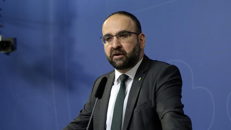 FILE - In this April 18, 2016 file photo, Sweden's Housing Minister Mehmet Kaplan appears before the media to confirm his resignation in Stockholm, Sweden. One refused to shake hands with a female journalist. Another compared Israel to Nazi Germany. A third was seen doing hand signs associated with Egypt's Muslim Brotherhood in the background of a live TV broadcast. The behavior of some Muslim members of Sweden's Green Party, which is part of a coalition government since 2014, has sparked concerns that the small environmentalist group may have been infiltrated by Islamists.  It also has triggered a wider discussion about whether Sweden has tried so hard to be inclusive and tolerant toward migrants that it's failed to stand up for its own feminist ideals.(Jessica Gow / TT via AP, File) SWEDEN OUT