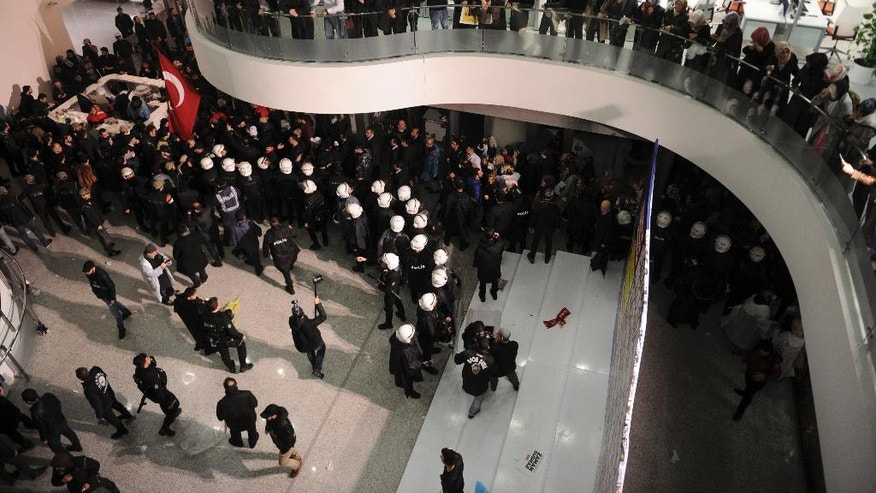 FILE- In this March 4, 2016, file photo, riot police enter the headquarters of Turkey's largest-circulation newspaper Zaman in Istanbul. Turkey's independent media landscape is rapidly shrinking as a result of government-sanctioned takeovers and forced closure. (AP Photo, File)