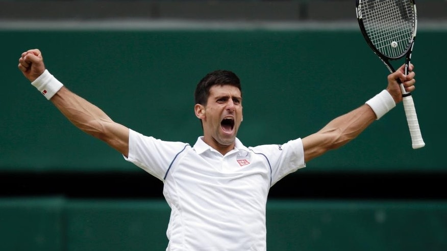 FILE - In this Sunday, July 12, 2015 file photo, Novak Djokovic of Serbia celebrates winning the men's singles final against Roger Federer of Switzerland at the All England Lawn Tennis Championships in Wimbledon, London.  Prize money at Wimbledon is increasing 5 percent this year, with the men's and women's singles champions to receive 2 million pounds ($2.9 million). Organizers announced Tuesday, April 26, 2016 that total prize money for the grass-court Grand Slam is going up to 28.1 million pounds ($40 million).  The prize for the singles champions has been raised by 6.4 percent, or 120,000 pounds ($175,000). (AP Photo/Pavel Golovkin, File)