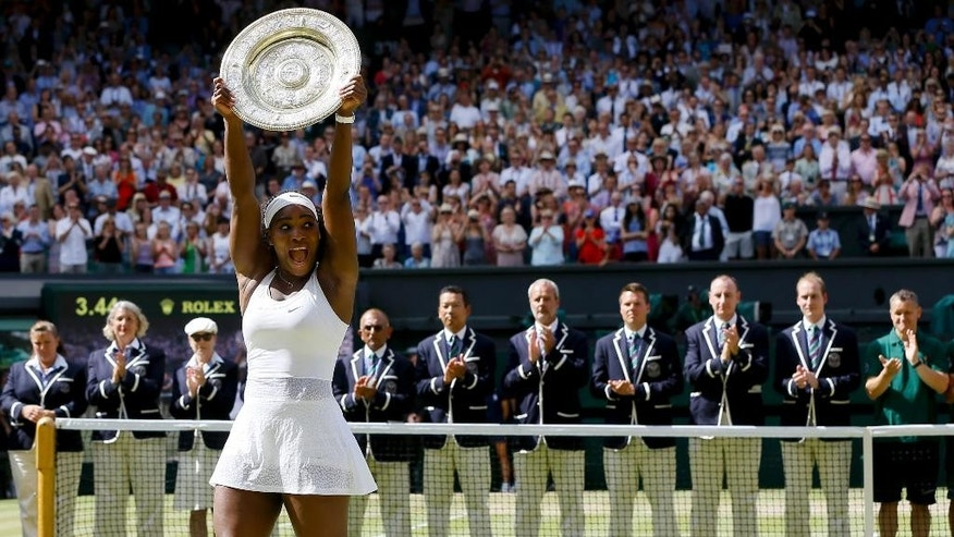FILE - In this July 11, 2015, file photo, Serena Williams, of the United States, holds up the trophy after winning the women's singles final against Garbine Muguruza, of Spain, at the All England Lawn Tennis Championships in Wimbledon, Prize money at Wimbledon is increasing 5 percent this year, with the men's and women's singles champions to receive 2 million pounds ($2.9 million). Organizers announced Tuesday, April 26, 2016 that total prize money for the grass-court Grand Slam is going up to 28.1 million pounds ($40 million).  The prize for the singles champions has been raised by 6.4 percent, or 120,000 pounds ($175,000). (AP Photo/Kirsty Wigglesworth, File)