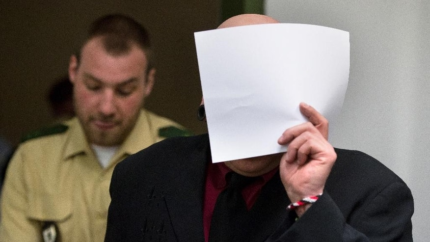 April 27, 2016: Member of the right-wing terror group Oldschool Society Markus W. (no second name given due to German law) covers his face as he is led into a courtroom in Munich, southern Germany. (The Associated Press)