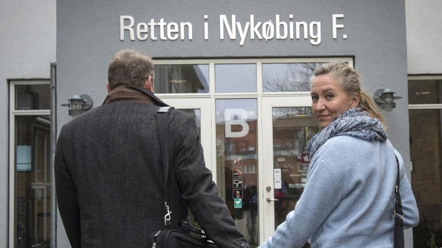 FILE- In this March 11, 2016 file photo, Danish Lisbeth Zornig Andersen, right, is photographed with her husband, Michael Rauno Lindholm outside the court, in Nykobing Falster, Norway, where they received a fine of 22500 Danish Kroner ($3420) for helping people transit through Denmark illegally. Already under fire for ordering police to seize jewelry from asylum-seekers, Denmark is seeing its humanitarian credentials once again being questioned as it presses smuggling charges against people who gave migrants a ride to neighboring Sweden. (Per Rasmussen, Polfoto via AP, File)  DENMARK OUT