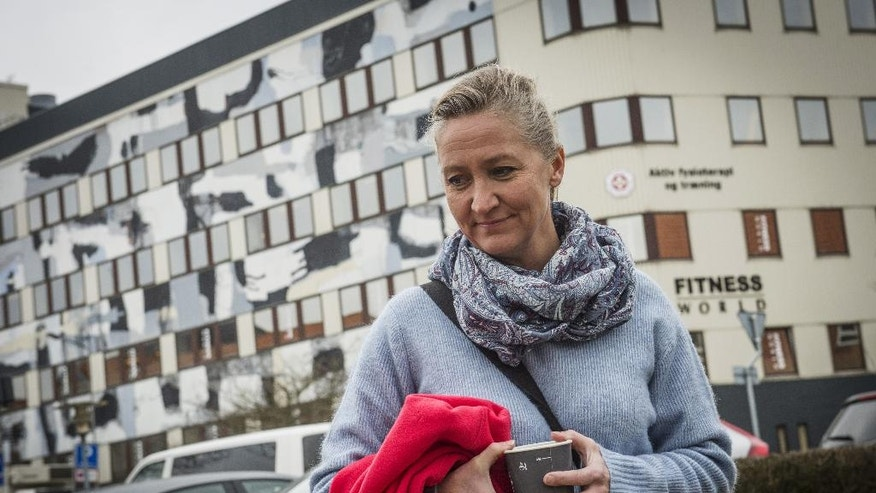 FILE- In this March 11, 2016 file photo, Danish Lisbeth Zornig Andersen is photographed outside the court, in Nykobing Falster, Norway, after receiving a fine of 22500 Danish Kroner ($3420) for helping people transit through Denmark illegally.  Denmark's public prosecutor's office says 230 people have been charged for helping people transit through the country illegally at the height of Europe's migrant crisis last fall. Prosecutors note that Danish trafficking laws don't distinguish between smuggling people for financial gain and doing it for humanitarian reasons.  (Per Rasmussen, Polfoto via AP, File)  DENMARK OUT