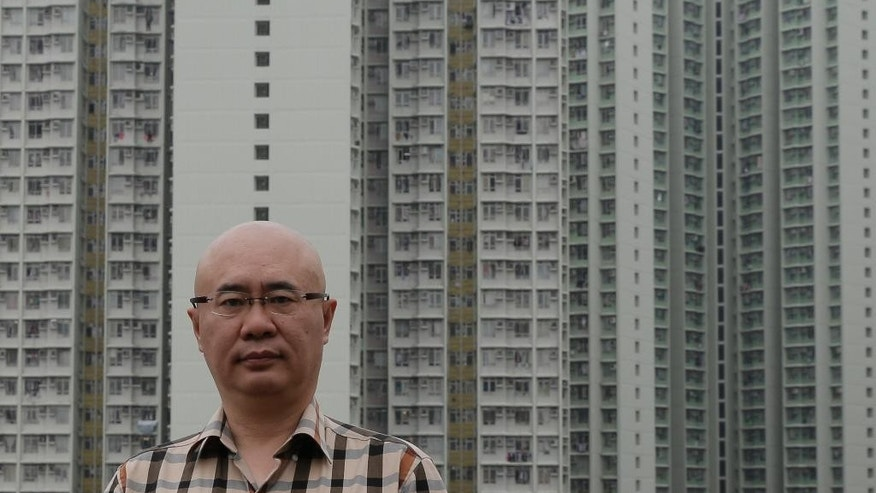 Kanwa Asian Defense publisher Andrei Chang poses in Hong Kong, Thursday, April 28, 2016. The publisher of a leading magazine on Chinese and regional defense issues says he's leaving Hong Kong out of concern he could be targeted by China's state security bodies, a further sign of how Beijing's growing presence is chilling the political atmosphere in the territory. (AP Photo/Kin Cheung)