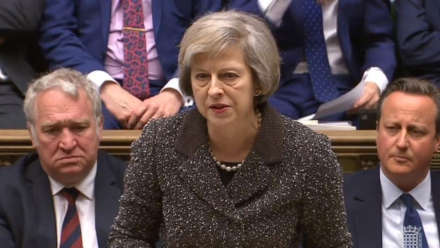 Home Secretary Theresa May makes a statement to MPs in the House of Commons, London, Wednesday April 27, 2016, following the jury verdict into the 96 soccer fans that died in the 1989 Hillsborough soccer stadium disaster.  The jury found that blunders by police and emergency services contributed to the deaths of 96 soccer fans who were crushed to death in a crowded stadium. (Parliament TV/  PA via AP) UNITED KINGDOM OUT - NO SALES - NO ARCHIVES