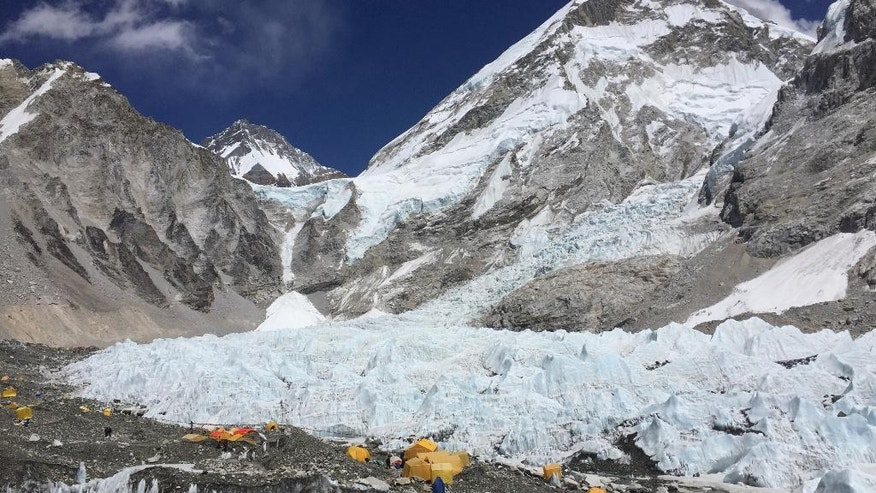 This April 10, 2016 photo shows yellow and orange tents at Everest Base Camp, pitched on the edges of the Khumbu icefall in Nepal. A trek to Everest Base Camp along mountain paths hugging it's deep gorges offers renewal and a test of mental and physical limits. A trek to Everest Base Camp along mountain paths that hug deep gorges offers renewal and a test of mental and physical limits. Along the way there are sore knees and altitude sickness, but the spectacular landscapes, friendly villagers and moments of tranquility make the journey an unforgettable experience. (AP Photo/Karin Laub)