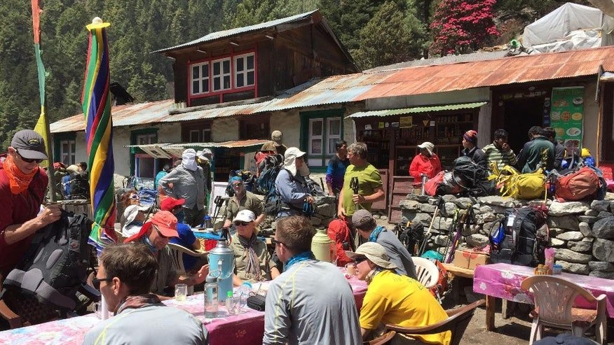 This April 6, 2016 photo shows trekkers at a rest stop north of the village of Namche Bazaar, Nepal. April falls into the peak season for trekking and the trail is often crowded. A trek to Everest Base Camp along mountain paths that hug deep gorges offers renewal and a test of mental and physical limits. Along the way there are sore knees and altitude sickness, but the spectacular landscapes, friendly villagers and moments of tranquility make the journey an unforgettable experience. (AP Photo/Karin Laub)