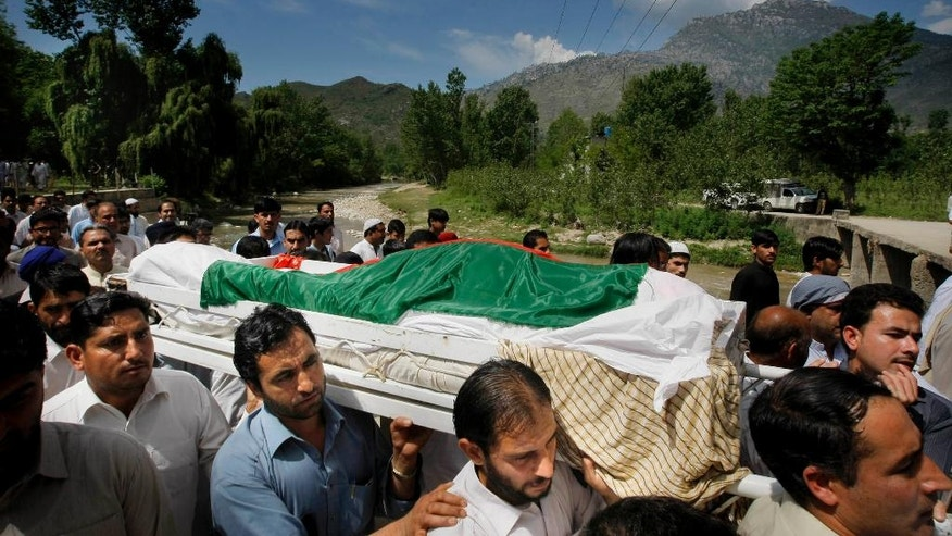 In this Saturday, April 23, 2016 photo, People carry the coffin of slain Pakistani Sikh lawmaker Sardar Suran Singh in Buner, Pakistan. The assassination last week of Singh, a member of the Khyber Pukhtunkhwa provincial legislature has shattered the community, heightened their fears and added to the despair felt by human rights groups over the growing intolerance of minority religions in Pakistan. (AP Photo/Mohammad Sajjad)