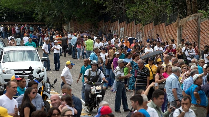 People line up to sign a petition, organized by the opposition, to initiate a recall referendum against Venezuela's President Nicolas Maduro in San Cristobal, Venezuela, Wednesday, April 27, 2016. Maduro's approval rating has plummeted amid spiraling triple-digit inflation, a deep recession and widespread shortages. (AP Photo/Fernando Llano)