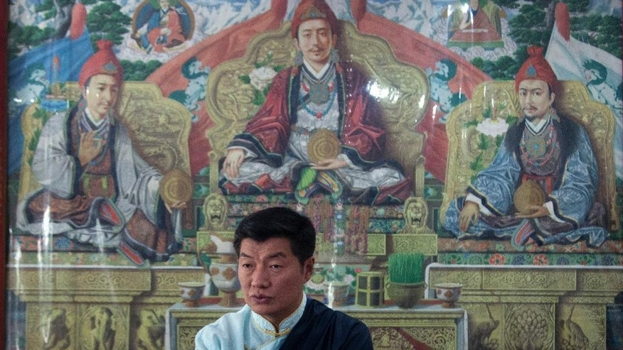 Lobsang Sangay, the incumbent prime minister of the Tibetan government-in-exile, speaks to media after being re-elected for second term in office in Dharmsala, India, Wednesday, April 27, 2016. (AP Photo /Ashwini Bhatia)
