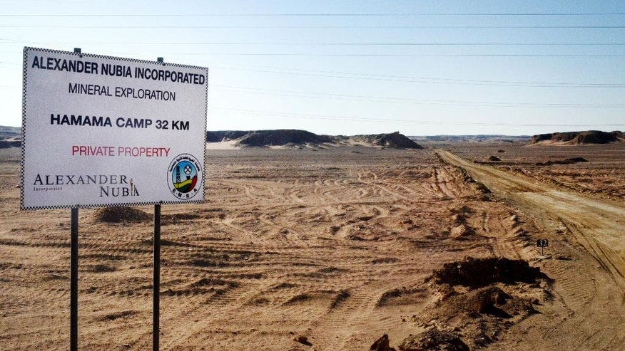 The Friday, April 15, 2016 photo, shows a sign marking the turn-off leading to the Hamama gold exploration site, deep in the desert east of Luxor, Egypt. Essential for ancient artifacts like the famed burial mask of Tutankhamun and still highly desired in Middle Eastern culture today, gold has been mined in Egypt for millennia. But experts say the country is heavily underexplored and that modern technology now allows much deeper excavation of the ancient sites shown on Pharaonic treasure maps. If developed, gold and mineral mining could prove a boon to the country at a time it is desperate for foreign currency, and provide jobs for its burgeoning population of 90 million. (AP Photo/Brian Rohan)