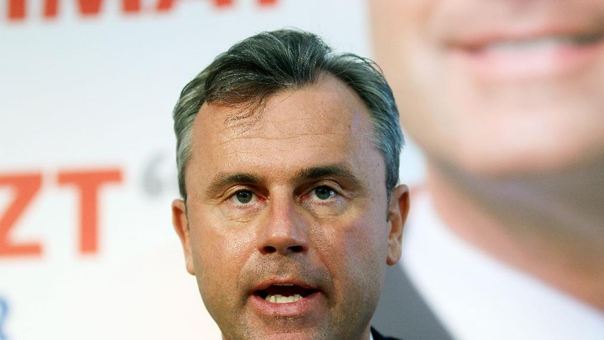 "FILE - In this Monday, March 14, 2016 file photo, Norbert Hofer, candidate for Sunday's presidential elections of Austria's Freedom Party, FPOE, speaks during a news conference in Vienna, Austria. Even before a vehemently anti-EU party won strong support in Austria, the European Union's top official acknowledged that the 28-nation bloc was in trouble. ""We are facing very tough times,"" European Commission President Jean-Claude Juncker told parliamentarians this month. ""We are not very popular when we advocate for Europe.""Those comments were reinforced just days later with the victory Sunday of an anti-EU right-wing party in the first round of Austria's presidential election. (AP Photo/Ronald Zak, File)"