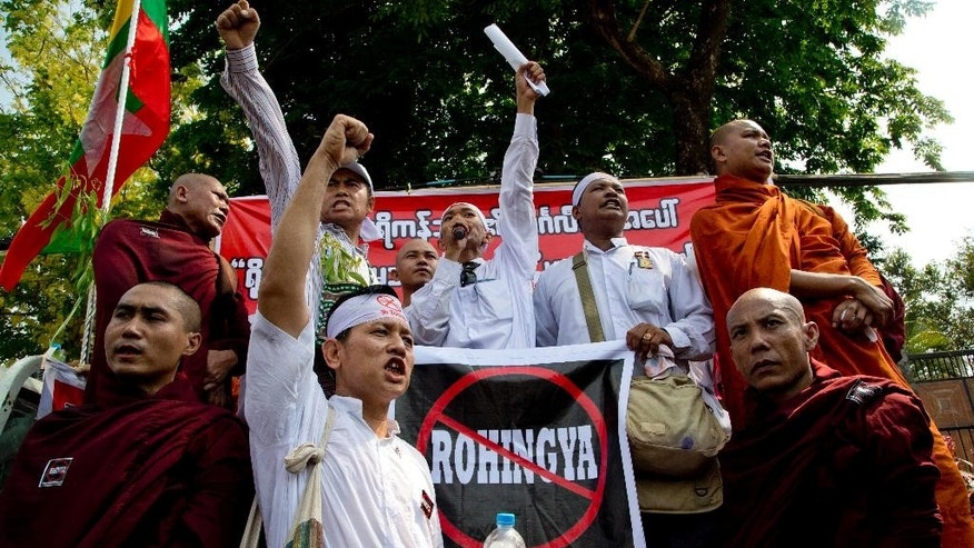 "Members of a Buddhist nationalist group shout slogans during a protest outside U.S. Embassy in Yangon, Myanmar against the embassy's April 20, 2016 statement with the word ""Rohingya"" Thursday, April 28, 2016. Myanmar nationalist believe long-persecuted and stateless Muslim minority in western Rakhine state who self identify themselves as ""Rohingya"" as illegal immigrants from neighboring Bangladesh and refer to them as ""Bengalis."" About 400 protesters, including Buddhist monks, marched in front of the embassy and held a protest rally. (AP Photo/Gemunu Amarasinghe)"