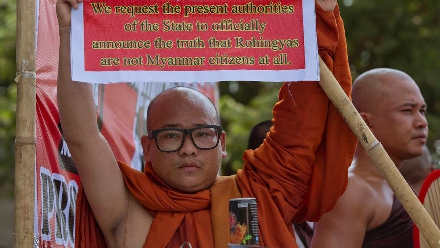 "A nationalist Buddhist monk displays a placard during a protest outside the U.S. Embassy in Yangon, Myanmar against the embassy's April 20 statement with the word ""Rohingya"" Thursday, April 28, 2016. Myanmar nationalist believe long-persecuted and stateless Muslim minority in western Rakhine state who self identify themselves as ""Rohingya"" as illegal immigrants from neighboring Bangladesh and refer to them as ""Bengalis."" About 400 protesters, including Buddhist monks, marched in front of the embassy and held a protest rally. (AP Photo/Gemunu Amarasinghe)"