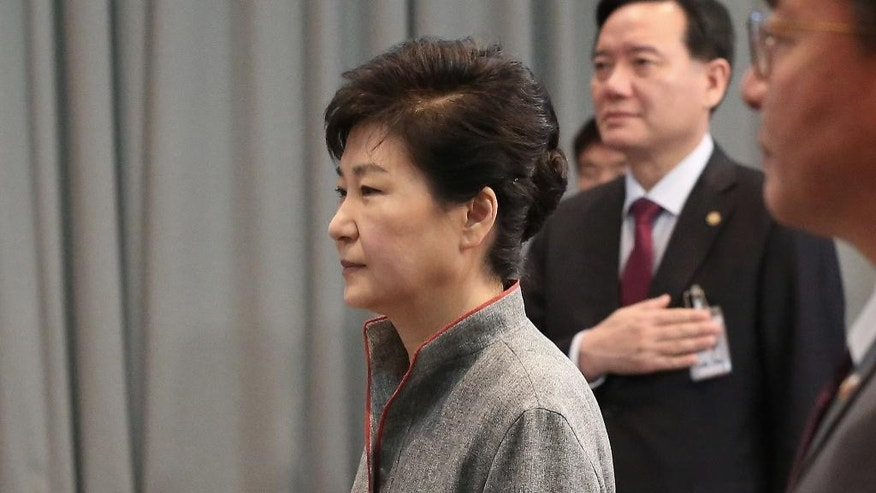 "South Korean President Park Geun-hye, left, salutes to the national flag during the National Security Council Meeting at the presidential house in Seoul, South Korea, Thursday, April 28, 2016. A suspected powerful intermediate-range North Korean missile crashed moments after liftoff Thursday, South Korea's Defense Ministry said, in what would be the second such embarrassing failure in recent weeks. Park said Thursday there were unspecified signs that a fifth test was ""imminent."" She warned another nuclear test would result in North Korea suffering harsher sanctions. (Lee Sang-hack/Yonhap via AP) KOREA OUT"