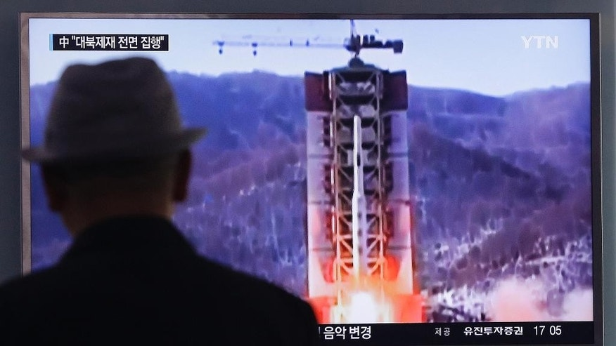 A man watches a TV news program showing a file footage of North Korea's rocket launch at Seoul Railway Station in Seoul, South Korea, Thursday, April 28, 2016. A suspected powerful intermediate-range North Korean missile crashed moments after liftoff Thursday, South Korea's Defense Ministry said, in what would be the second such embarrassing failure in recent weeks. (AP Photo/Ahn Young-joon).