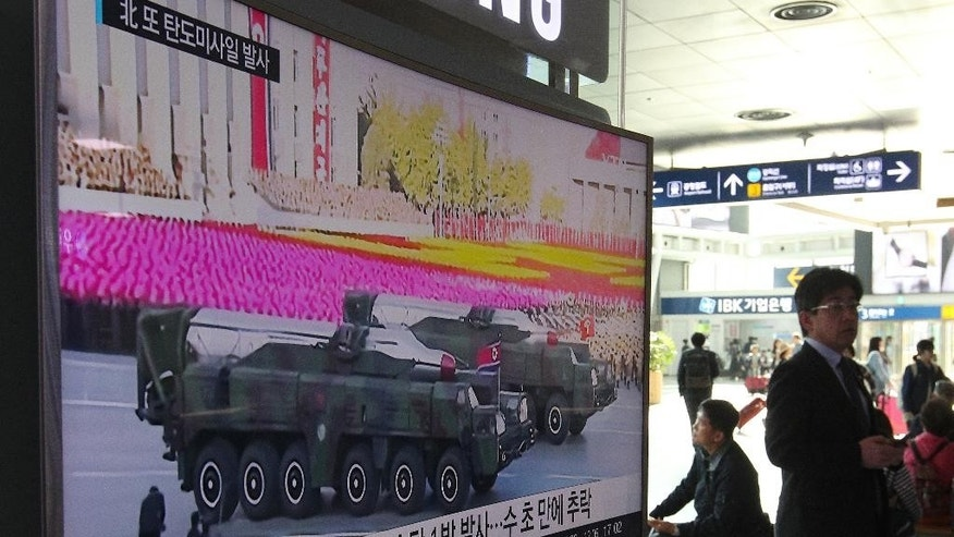 "A man walks by a TV news program showing a file footage of North Korean missiles paraded at a military parade in Pyongyang, at Seoul Railway Station in Seoul, South Korea, Thursday, April 28, 2016. A suspected powerful intermediate-range North Korean missile crashed moments after liftoff Thursday, South Korea's Defense Ministry said, in what would be the second such embarrassing failure in recent weeks. The letters on a screen read: ""North Korean launch of a Musudan missile appears to have failed."" (AP Photo/Ahn Young-joon)."