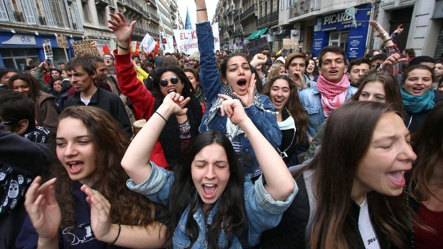 Students shout slogans during a demonstration in Marseille, southern France, Thursday, April 28, 2016, during a nationwide day of protest.  Student organizations and employee unions have joined to call for protests across France to reject a government reform relaxing the 35-hour working week and other labour rules.  (AP Photo/Claude Paris)