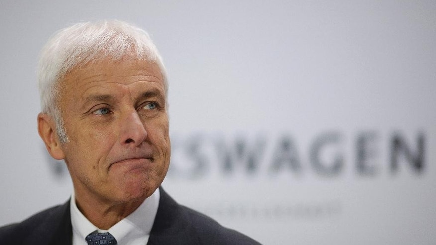 Volkswagen CEO Matthias Mueller attends the company's annual press conference in Wolfsburg, Germany, Thursday, April 28, 2016. Mueller said the company will launch new electric vehicles and set up a new firm focused on operations like car-sharing as it seeks to get past its scandal over cheating on diesel emissions tests. (AP Photo/Markus Schreiber)