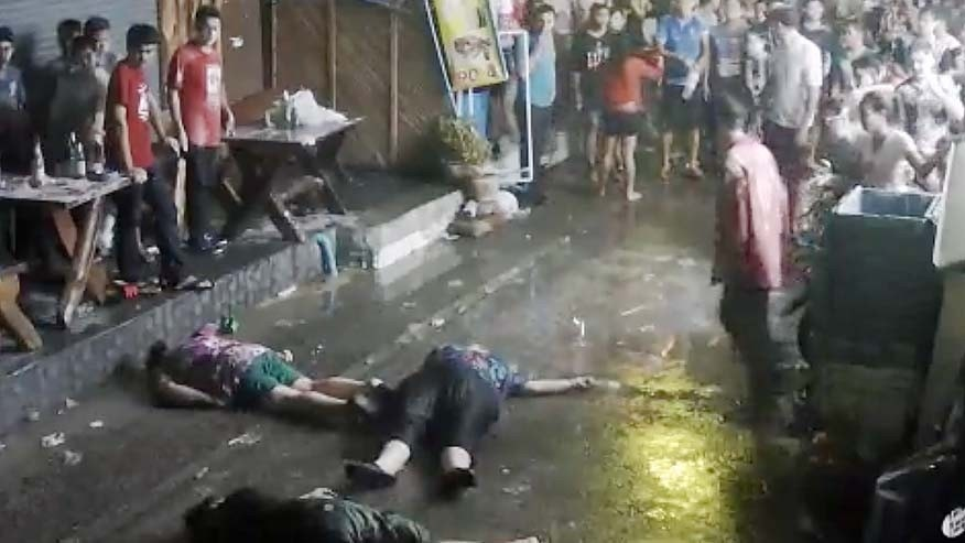 In this April 13, 2016 image taken from video released by the Hua Hin Municipality, an elderly British couple and their son are on the ground after they were savagely attacked during a family vacation in Hua, Hin, Thailand.