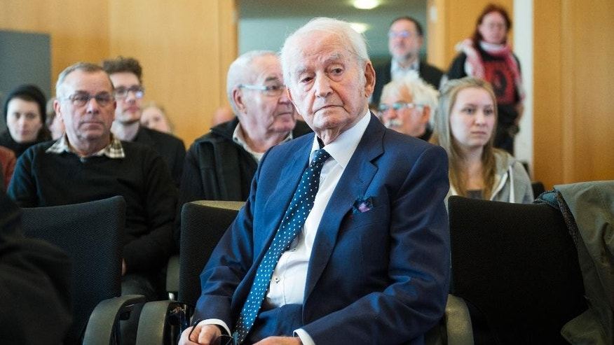 Auschwitz survivor Leon Schwarzbaum attends the trial against 94-year-old former SS sergeant Reinhold Hanning in Detmold, Germany, Friday, April 29, 2016. Henning plans to make his first statement to the German court since his trial opened in February on 170,000 counts of accessory to murder over allegations he served as a guard at the Nazis' Auschwitz death camp. (Bernd Thissen/Pool Photo via AP)