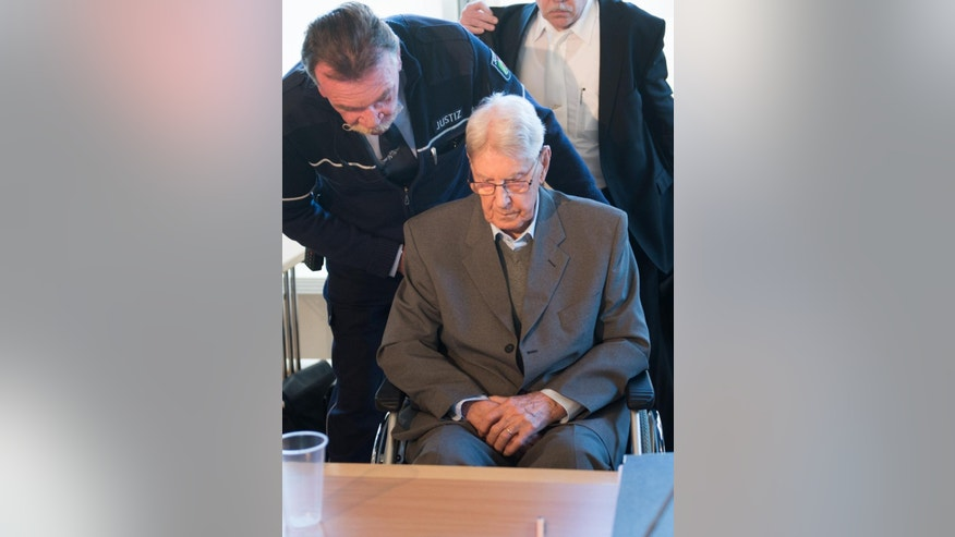 94-year-old former SS sergeant Reinhold Hanning sits in the courtroom in Detmold, Germany, Friday, April 29, 2016. Henning plans to make his first statement to the German court since his trial opened in February on 170,000 counts of accessory to murder over allegations he served as a guard at the Nazis' Auschwitz death camp. (Bernd Thissen/Pool Photo via AP)