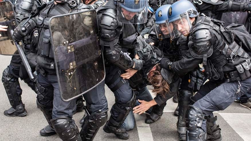 April 28, 2016: A protestor is arrested by riot police during a protest against the proposed changes to France's working week and layoff practices, in Lyon, central France.