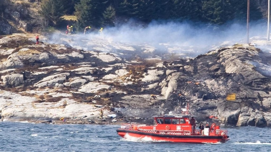 A search and rescue vessel patrols off the island of Turoey, near Bergen, Norway, as emergency workers attend the scene of a helicopter crash believed to have 13 people aboard, Friday April 29, 2016.  The helicopter carrying around 13 people from an offshore oil field crashed Friday near the western Norwegian city of Bergen, police said. Many are feared dead.  (Rune Nielsen / NTB scanpix via AP) NORWAY OUT