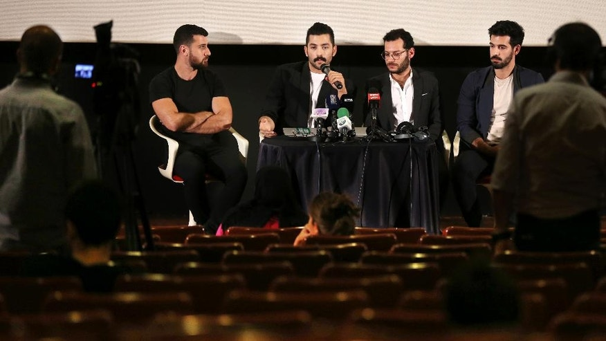 "Lebanese Hamed Sinno, second left, lead singer and song writer of the Lebanese group Mashrou' Leila or ""Leila's Project"" band, speaks during a press conference with his band musicians, in Beirut, Lebanon, Thursday, April 28, 2016. Jordan has banned a performance by a popular Lebanese rock band on religious grounds, spurring criticism of the Western-allied kingdom, which portrays itself as an island of tolerance in a turbulent region. (AP Photo/Hussein Malla)"