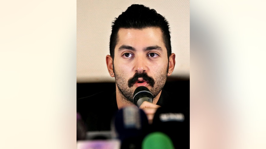 "Lebanese Hamed Sinno, lead singer and song writer of the Lebanese group Mashrou' Leila or ""Leila's Project"" band, speaks during a press conference with his band musicians, in Beirut, Lebanon, Thursday, April 28, 2016. Jordan has banned a performance by a popular Lebanese rock band on religious grounds, spurring criticism of the Western-allied kingdom, which portrays itself as an island of tolerance in a turbulent region. (AP Photo/Hussein Malla)"