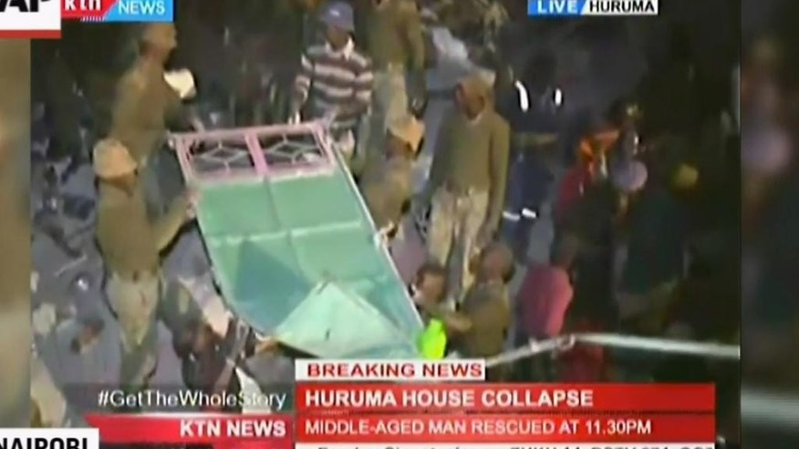 This frame grab from a video provided by KTN News shows aftermath of a building collapse in Nairobi, Kenya, Friday, April 29, 2016.   The six-story residential building in a low income area of the Kenyan capital collapsed Friday under heavy rain and flooding, trapping an unknown number of people in the rubble, Kenyan officials said. A search-and-rescue team managed to pull three children and an adult out from the remains of the building in the Huruma area, the Kenya Red Cross said. It was not immediately clear whether there were fatalities. (KTN News via AP)