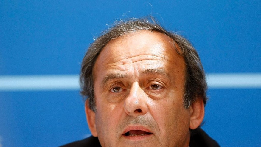 FILE - In this Aug. 28, 2015 file photo UEFA President Michel Platini delivers his speech during a press conference after the soccer Europa League draw ceremony at the Grimaldi Forum, in Monaco. Michel Platini expects Sepp Blatter to attend as a witness in his appeal against a six-year FIFA ban at the Court of Arbitration for Sport on Friday. (AP Photo/Claude Paris, File)