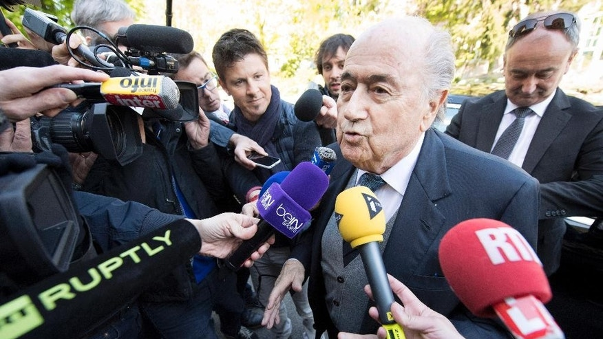 Former FIFA president Sepp Blatter arrives surrounded by the media to attend as a witness the hearing of UEFA President Michel Platini at the international Court of Arbitration for Sport, CAS, in Lausanne, Switzerland, Friday,  April 29, 2016. Platini has begun his appeal at the CAS against a six-year ban from football by FIFA over a US dollar 2 million payment approved by Blatter. (Laurent Gillieron/Keystone via AP)