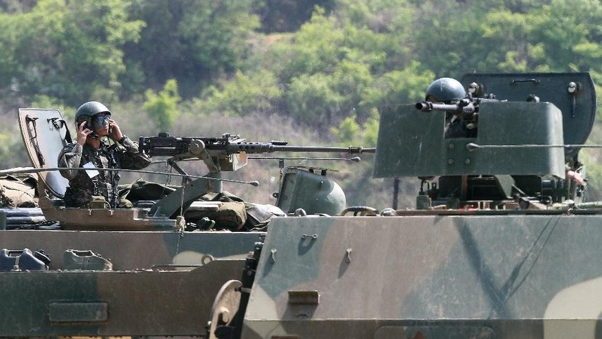 "A South Korean army soldier mans a K-9 self-propelled artillery vehicle during an exercise in Paju, near the border with North Korea, South Korea, Friday, April 29, 2016. North Korea on Friday accused U.S. soldiers of trying to provoke its frontline troops with ""disgusting"" acts and encouraging South Korean soldiers to aim their guns at the North.(AP Photo/Ahn Young-joon)"