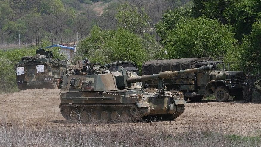 "A South Korean army K-9 self-propelled artillery vehicle moves during an exercise in Paju, near the border with North Korea, South Korea, Friday, April 29, 2016. North Korea on Friday accused U.S. soldiers of trying to provoke its frontline troops with ""disgusting"" acts and encouraging South Korean soldiers to aim their guns at the North.(AP Photo/Ahn Young-joon)"