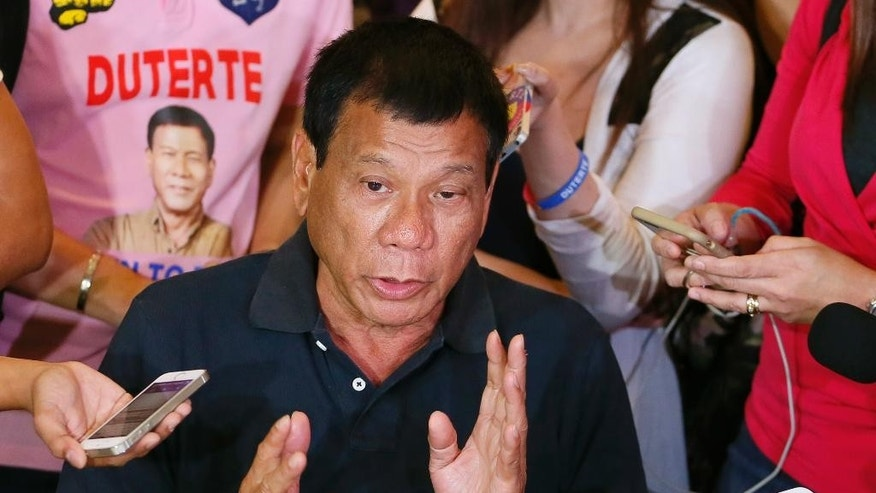 Front-running Presidential candidate Rodrigo Duterte answers questions from the media following his meeting with some politicians who shifted political support to his camp Friday, April 29, 2016 in Manila, Philippines. Duterte is facing another controversy after allegedly failing to declare his P211 million Pesos ($4.5 million US Dollars) 2014 bank deposits as required by law. (AP Photo/Bullit Marquez)