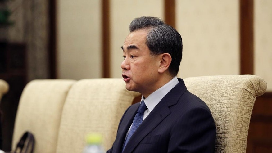 China's Foreign Minister Wang Yi talks to Japanese Foreign Minister Fumio Kishida, during a meeting at Diaoyutai State Guesthouse, in Beijing, China, Saturday, April 30, 2016. (Jason Lee/Pool Photo via AP)