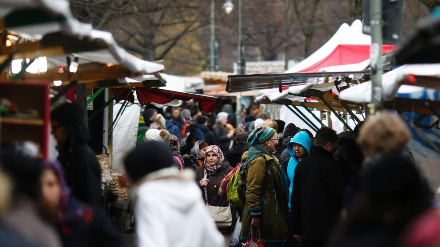 In this March 18, 2016 photo people crowd the so-called Turkish market at the district Neukoelln in Berlin, Germany. The market runs mostly by vendors with a Turkish migration background and is located at the borough of Neukoelln which has one of the highest percentage of immigrants in Berlin. (AP Photo/Markus Schreiber)