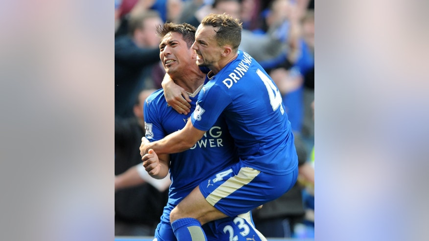 FILE - In this Sunday, April 17, 2016 file photo Leicester City's Leonardo Ulloa celebrates with teammates Leicester City's Danny Drinkwater after scoring a last minute penalty during the English Premier League soccer match between Leicester City and West Ham United at the King Power Stadium in Leicester, England. Bought from second-division team Brighton in 2014, Ulloa goal tally of 13 helped Leicester retain its Premier League status last season. His role has been reduced with the arrival of Okazaki this time around, but his decisive strike in the 1-0 win against Norwich in February could prove crucial to securing the title. (AP Photo/Rui Vieira, File)