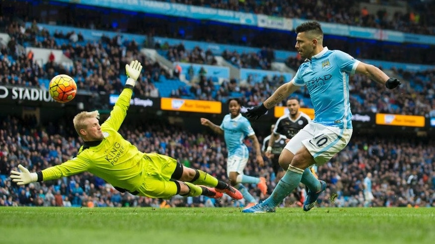 FILE - In this Saturday Feb. 6, 2016 file photo Manchester City's Sergio Aguero, right, shoots wide past Leicester City's goalkeeper Kasper Schmeichel during the English Premier League soccer match between Manchester City and Leicester City at the Etihad Stadium in Manchester, England.  The son of title-winning Manchester United goalkeeper Peter Schmeichel, Kasper is a Denmark international who has played for Leicester since 2011, when the club was in England's second division. He has 15 shutouts this season in the league. (AP Photo/Jon Super, File)
