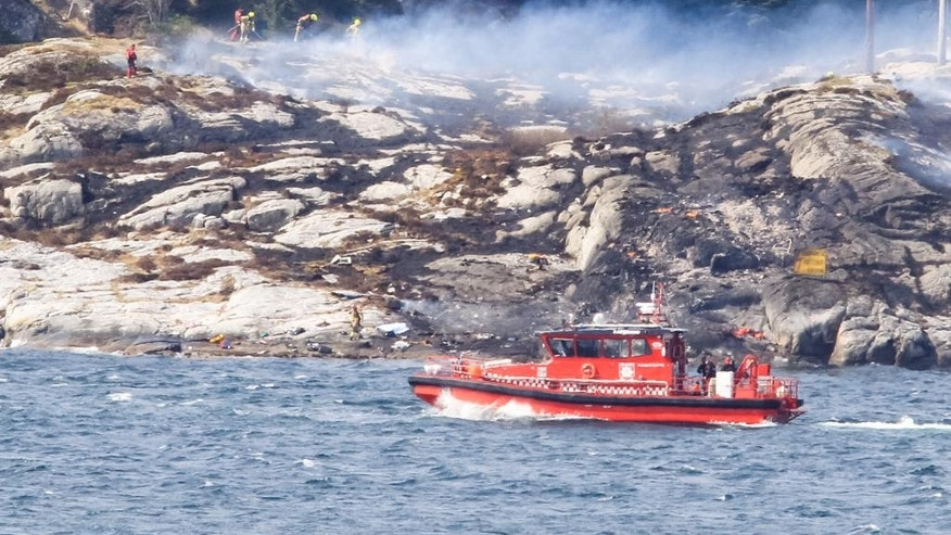 A search and rescue vessel patrols off the coast of the island of Turoey, near Bergen, Norway, as emergency workers attend the scene after a helicopter crashed believed to be have 13 people aboard, Friday April 29, 2016.  A helicopter carrying around 13 people from an offshore oil field crashed Friday near the western Norwegian city of Bergen, police said. Many are feared dead.  (Rune Nielsen / NTB scanpix via AP) NORWAY OUT